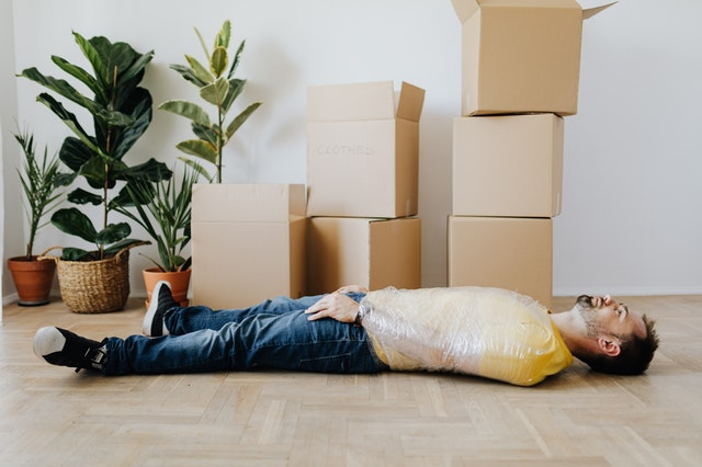 A man surrounded by packing materials.