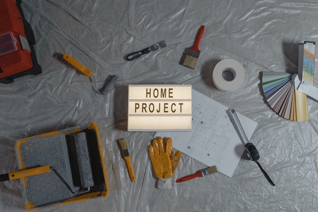 A 'home project' sign and some tools.